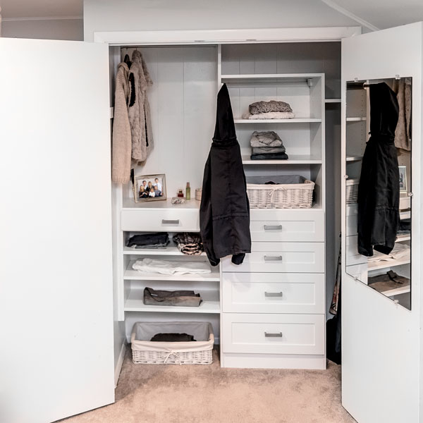 reach-in wall closet with drawers that includes a jewelry drawer organizer