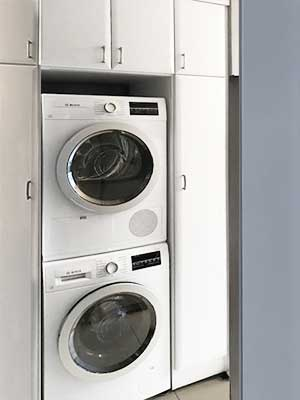 custom laundry room storage ideas for stacking washer and dryer