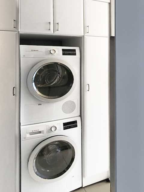 white laundry room storage with italia drawer fronts