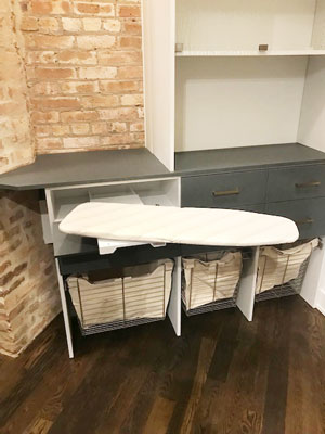 drawer ironing board for closet with brick wall