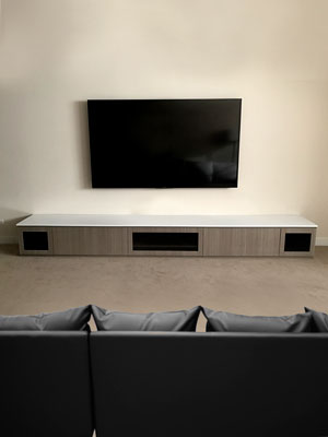 modern media center with high gloss countertop and custom inserts