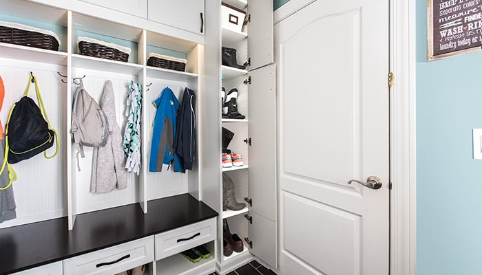 shoe tower closet in mudroom next to back door