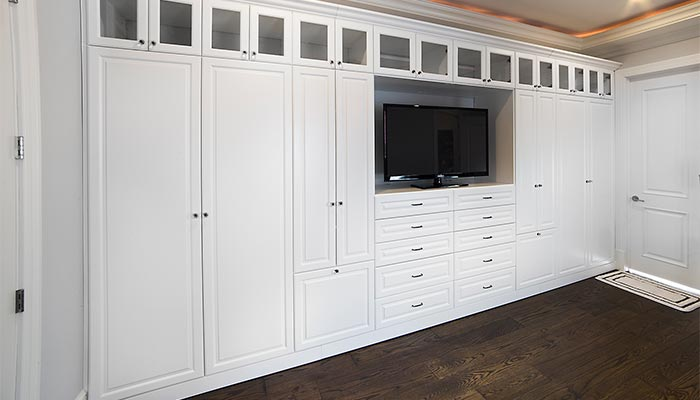 Custom Wall Unit Storage System For The Bedroom Includes A Place Everything