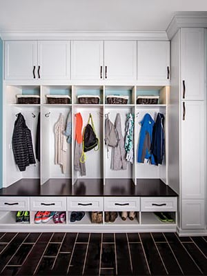 bright mud room design with with extra shoe storage