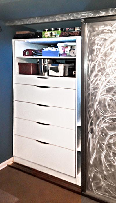 reach-in closet with scalloped drawers