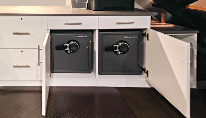 custom cabinet to conceal two safes
