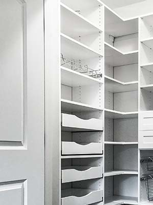 pull-out pantry shelves maximize storage space in pantry closet