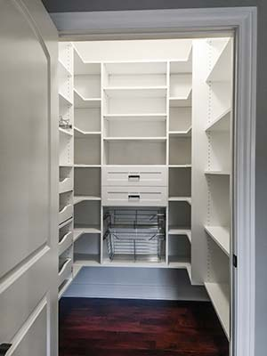 custom pantry design with pull-out pantry shelves
