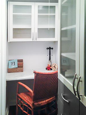 home office nook with desk and storage cabinets fits small space