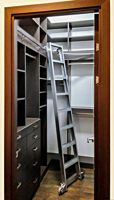 Tall Narrow Closet Design With Rolling Ladder