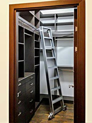 tall, narrow closet design with rolling ladder
