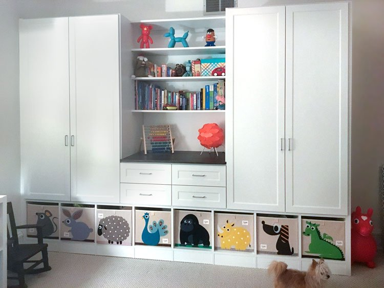 custom wardrobe storage cabinets and closet wall unit for a young child's bedroom