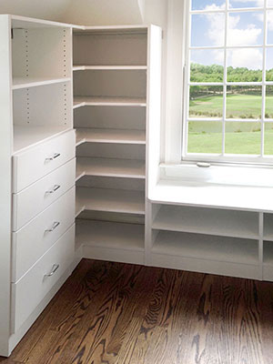 walk-in with window bench and shoe cubbies