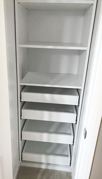 bathroom linen closet with pull-out shelves