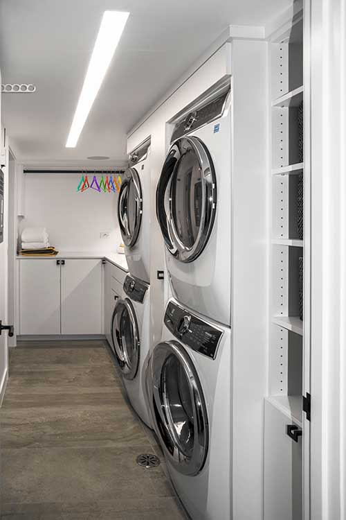 Custom laundry room cabinets for a small narrow basement laundry room