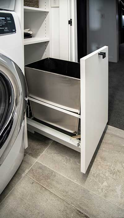 Laundry design includes a pull-out trash bin