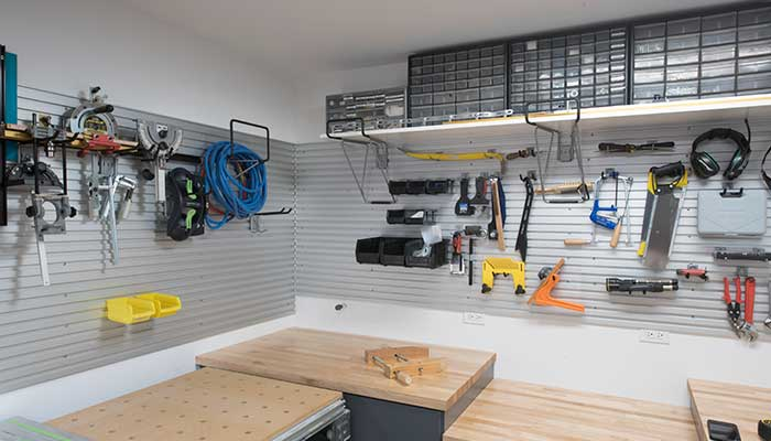 wood shop layout includes different height countertops for different tools