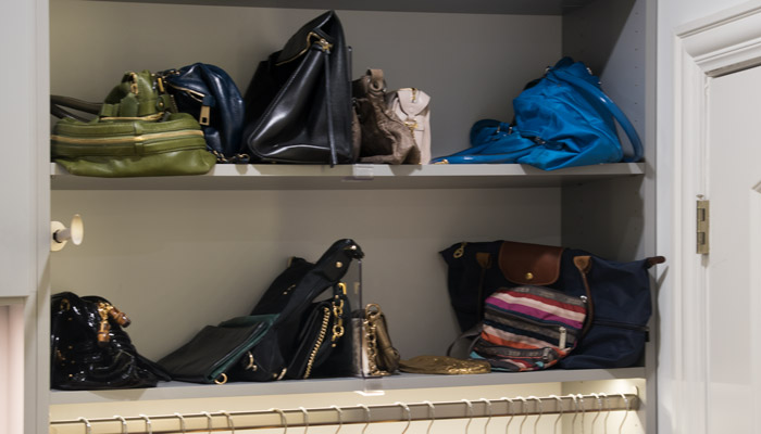 acrylic shelf dividers to organize purses