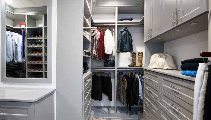her side featuring double closet hutch, hanging space, and shelves