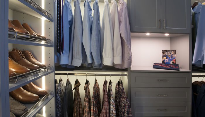 his side with closet hutch, hanging space, and shoe shelves