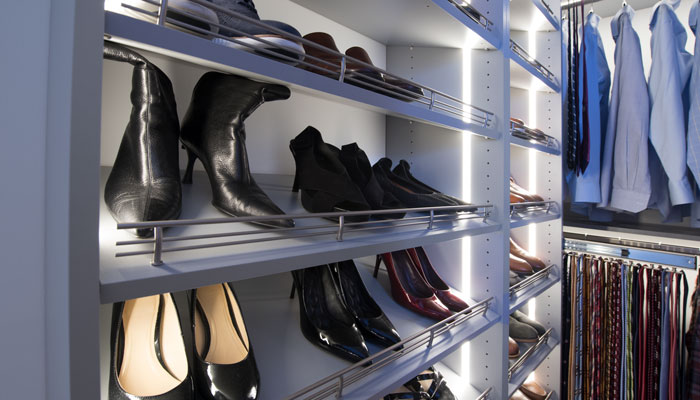shoe tower with vertical lighting system and shoe fence