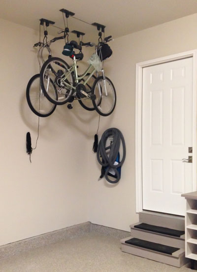 bicycles stored overhead with pulley bike storage