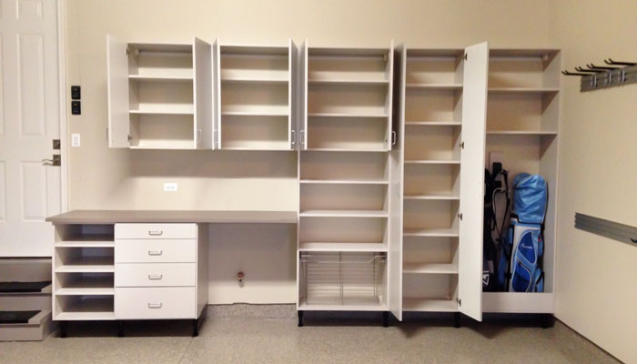 Custom Garage Cabinetry with Wall Track and Pulley Bike Storage