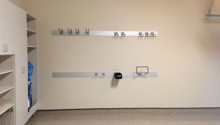 garage Omni wall track organization system for lawn and garden equipment