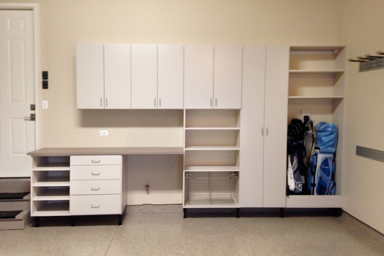custom garage cabinetry for storing sporting goods and custom work bench
