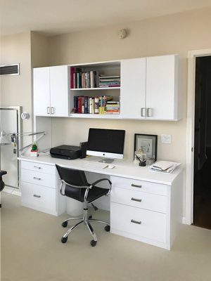 Custom home office design with wire management cabinet