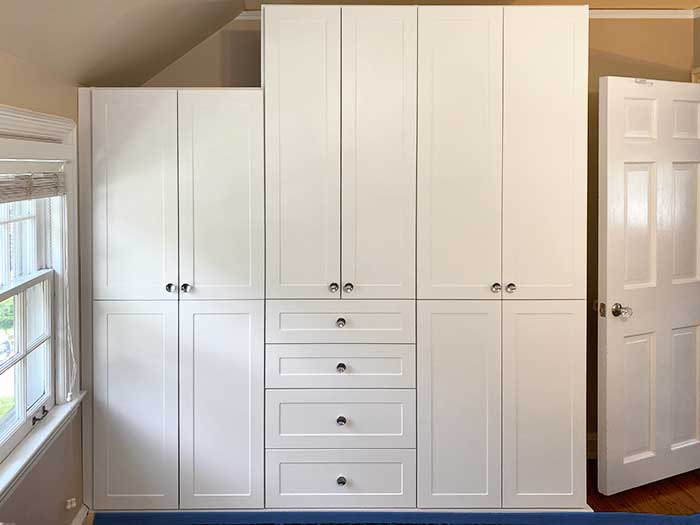 Custom built-in provides ample storage for bedroom