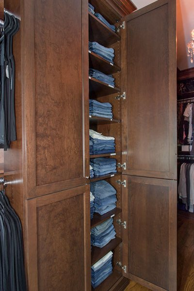 Custom door panels and shelving in all wood closet system