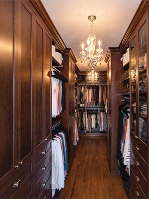 Wood custom closet design with solid wood doors, drawers and closet organizers