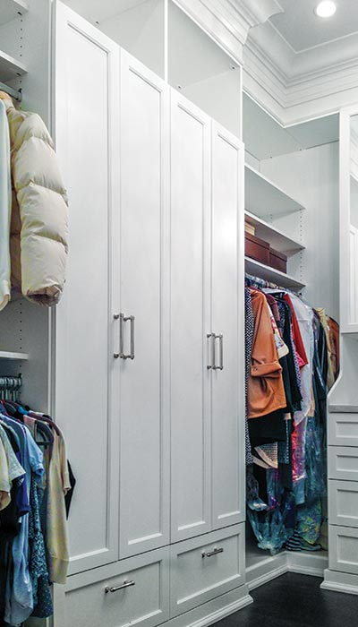 Craftsman style closet design with built-in cabinetry