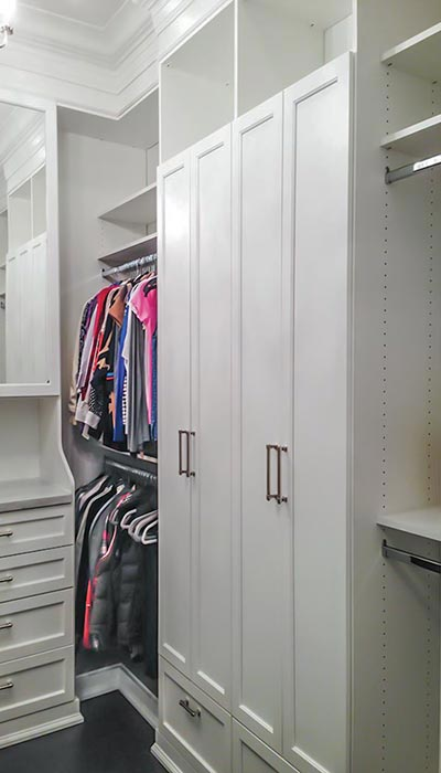 Custom closet with built-in mirrored hutch