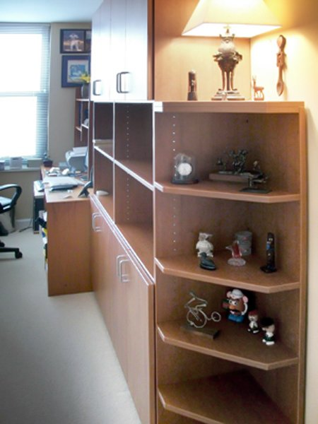 Home office wall units with angled shelves on bookcase corner and custom desk