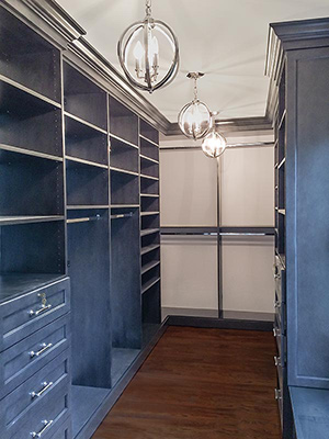 Custom walk-in closet in gray wood and stainless steel accents