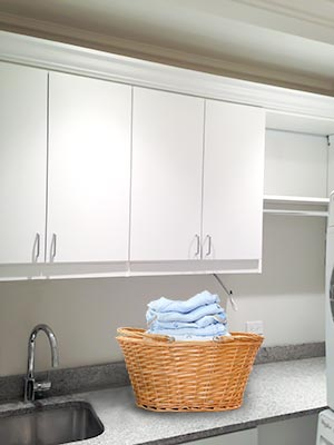Custom upper laundry cabinets and shlves