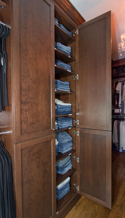 custom walk in closet with lowland doors
