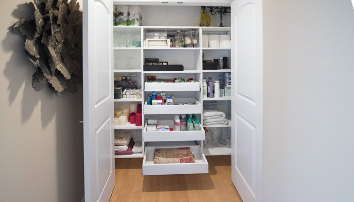 custom hallway closet with pull-out shelves