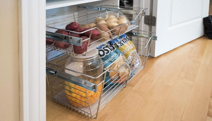 Pantry pull out chrome baskets for perishables and snacks