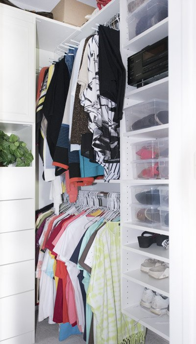 hanging rods extend into alclove for small closet solutions