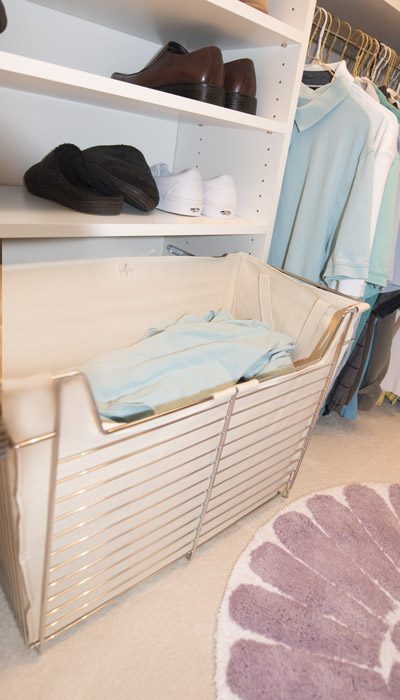 pull-out canvas-lined hamper and shelving system for a man's shoes