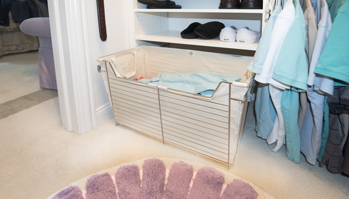 custom pull-out hamper for small walk in closet