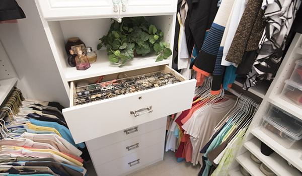 Walk-in closet designs with hanging rod alcloves and center drawer system and closet hutch