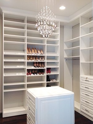 Custom closet design with shoes shelves and closet island