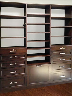 Custom wall unit design with solid wood shelving and media center organizers