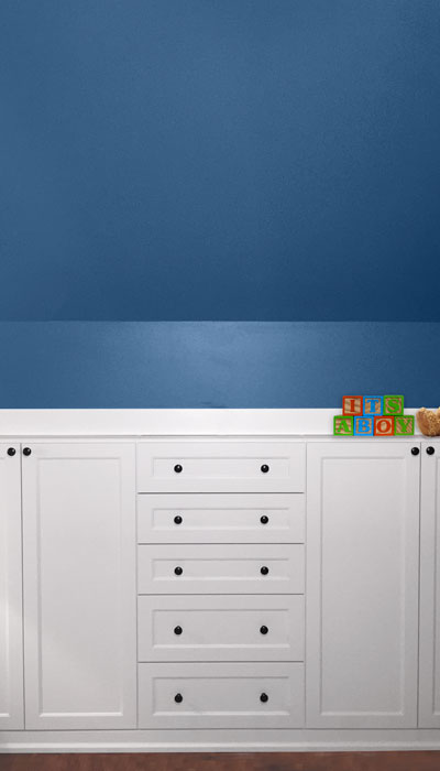 Wall Closets Units Are Built In To The Knee Wall In A Sloped Ceiling Room