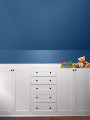 nursery closet designed in sloped ceiling room