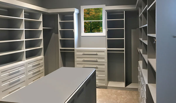custom master walk-in closet ideas with closet island and pull down rods